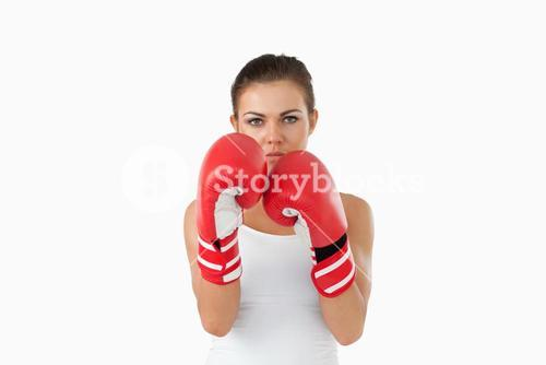 Female boxer in defensive stance