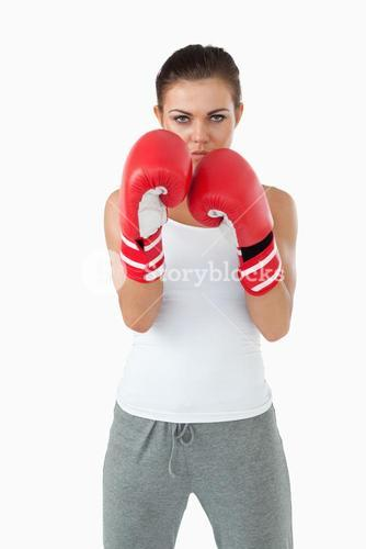 Young female boxer in defensive stance
