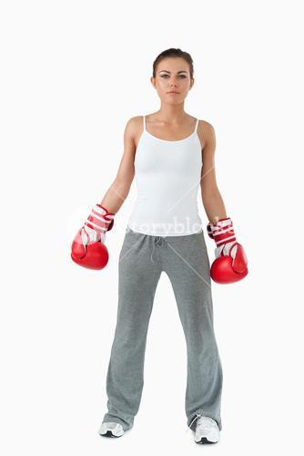 Atletic female with boxing gloves on