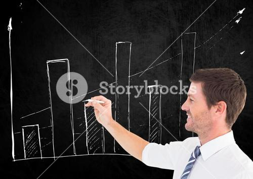 Businessman drawing graph