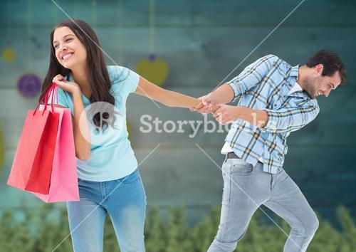 Man and woman fighting for consumerism