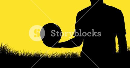 Shadow of man with soccer ball