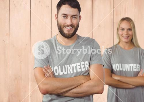 Couple volunteers arms crossed