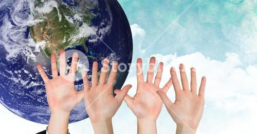 Hands up in front of earth