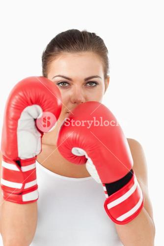 Female boxer behind cover
