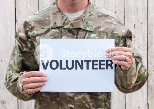 Military with sign volunteer
