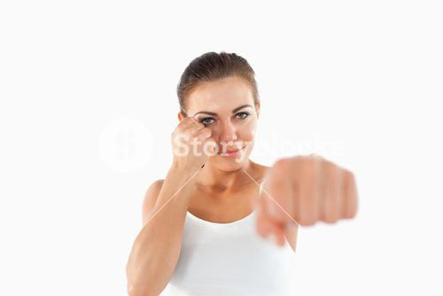 Female martial arts fighter attacking with left fist