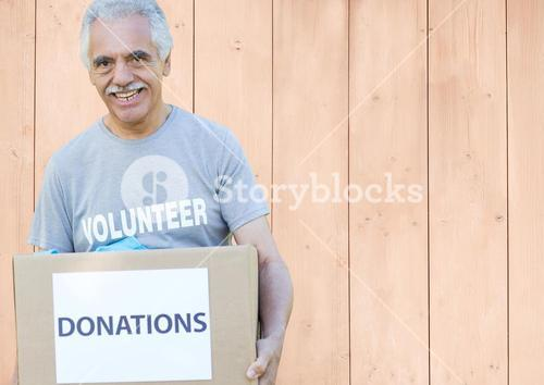 Digital composite of volunteer holding donation box