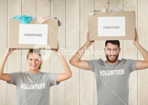 Digital composite of volunteers holding donation boxes
