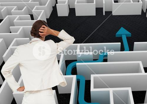 Digital composite of woman standing in front of maze