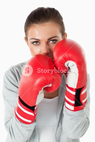 Portrait of a woman with boxing gloves