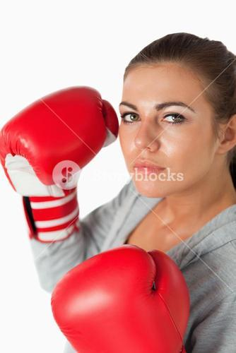 Portrait of a cute woman with boxing gloves