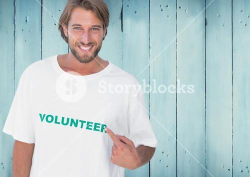 digital composite of volunteer pointing at his shirt