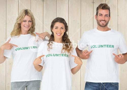 digital composite of volunteers pointing at their shirts