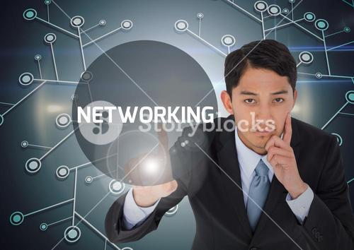 Digital composite of business man pointing at networking sign