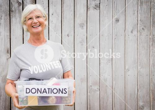 digital composite of volunteer carrying donation box