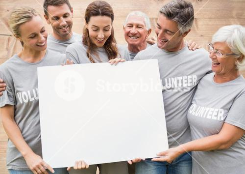 Composite of group of volunteers holding sign