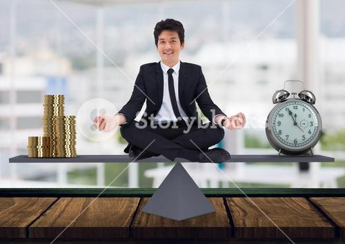 Digital composite of business man sitting on scale