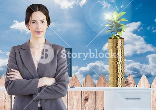 Digital composite of business woman with crossed arms