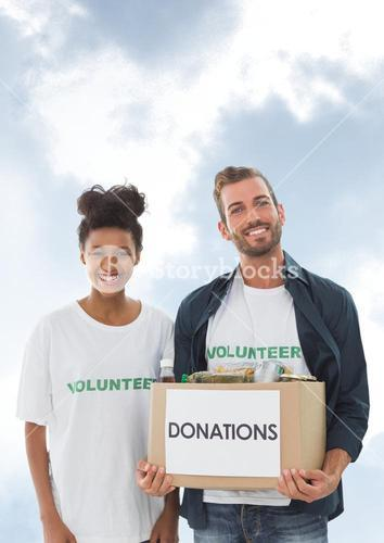 Two volunteers holding a donation box