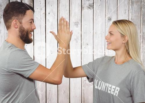 Two volunteers high five
