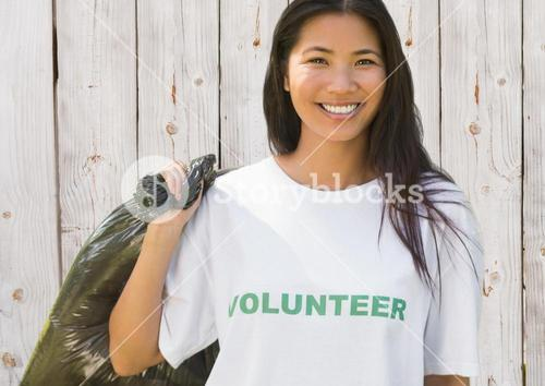 Volunteer woman with refuse sack