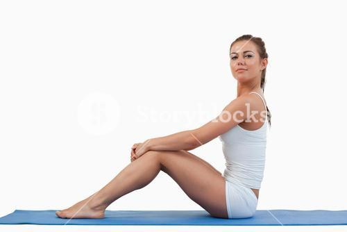 Woman sitting on a foam mat