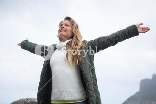 Happy woman with arms wide open