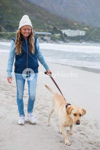 Woman walking along with pet dog