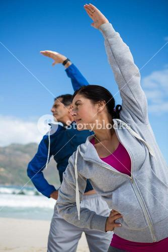 Couple performing stretching exercise