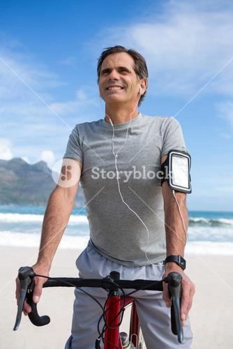 Smiling man with bicycle