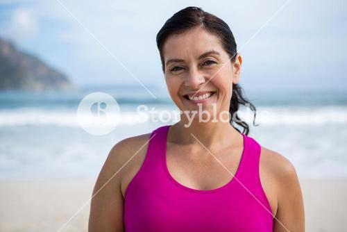 Portrait of smiling woman on beach