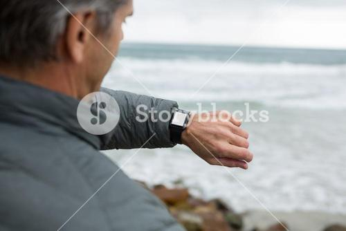 Man checking the time on smartwatch