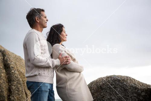 Thoughtful couple standing on beach
