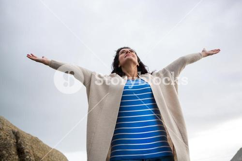 Woman standing with arms outstretched