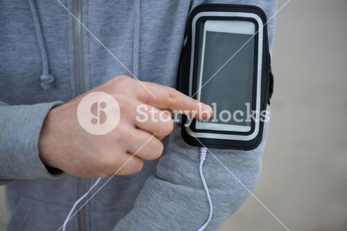 Mid section of man using mobile phone