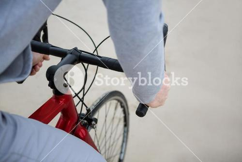 Mid section of man riding bicycle