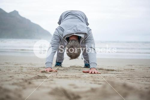 Man push-up on beach