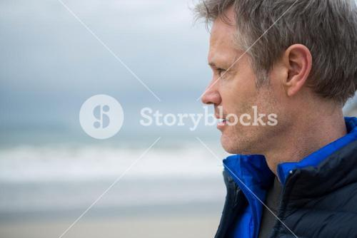 Close-up of thoughtful man on beach