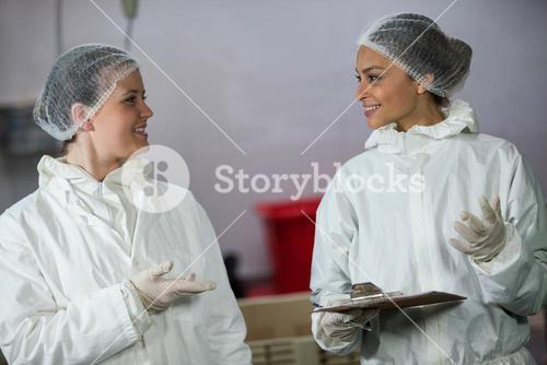 Female butchers interacting with each other