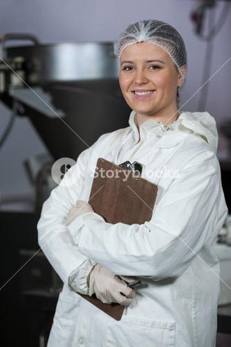 Female butcher holding clipboard