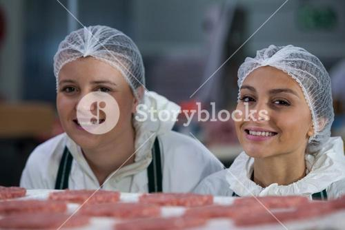 Female butchers at meat factory