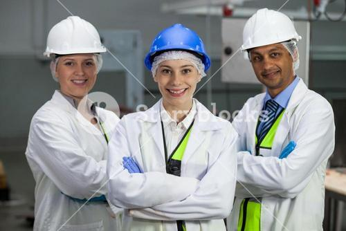 Team of technicians standing with arms crossed