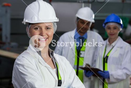 Technicians standing in meat factory