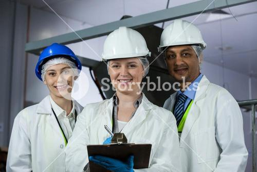 Technicians standing with a clipboard