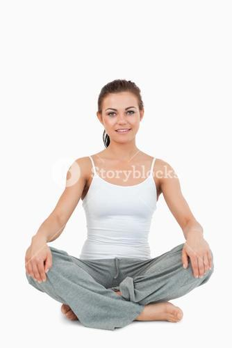 Portrait of a woman in the Sukhasana position