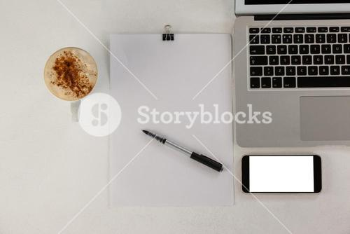 Laptop with smartphone and cup of coffee