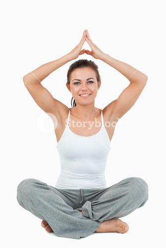 Portrait of a woman in a meditation position