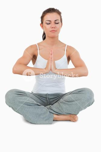 Portrait of a young woman in the Sukhasana position