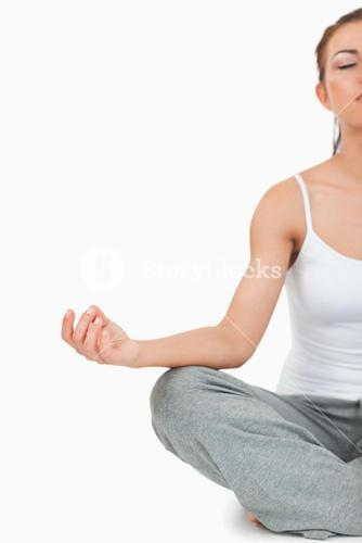 Portrait of a meditating woman in the Sukhasana position
